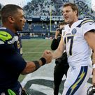 Russell Wilson of the Seattle Seahawks and Philip Rivers of the Los...