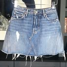 """GRLFRND Eva Distressed Denim Mini Skirt Size 24 GRLFRND Eva High waist A-Frame Gusset Skirt -Walk This Way Sz 24  Current on Revolve, Net-a-porter, Intermix.    Retail $160   For denim days that call for a sexier feel.  High waisted, mini silhouette sits above hips for a flattering fit while distressed detail lends to a cool, lived-in feel.  •100% cotton •High waist  •true to size Between sizes?, go smaller  •Button fly, Raw Hem   ▪️Waist 12.5"""" ▪️Length 15"""" ▪️Hips 19""""  Model in Sz 24 Measurement"""