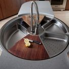 This Rotating Sink Has a Cutting Board, Colander, and It Spins. Wait, What?