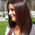 Cherry red highlights in dark brown hair