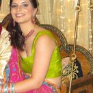 Indian lady in green and pink saree dress