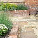 Modern Cottage Garden using traditional materials   Buckinghamshire garden with oak arbour, Yorkshire stone patio and local brick walling