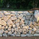 Stone gabion baskets limestone walls Garden landscaping lime stone rocks UK