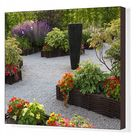 Flower beds and sculpture in the Garden of Edible Flowers. Box Canvas Print. Flower beds and sculpture in the Garden of Edible Flowers, Fruit Gardens.