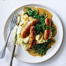 Sausages with creamy spinach sauce and garlic and caper mash recipe | delicious. magazine