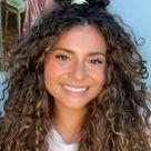 Curly Bun Half Up Half Down Hairstyle