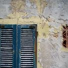 Poster: Lladó's Weathered House with Shutters at Bastoni Marco Polo, A