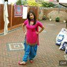 Pakistani Desi Girl in Punjabi Red Kameez and Blue Salwar Suit