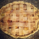 I made this homemade apple pie last night. Officially in fall spirits! Paired well with our Duck pond 2009 Chardonnay.   Easy recipe!!! 1/2 cup unsalted butter 3 table spoons flour 1/2 cup sugar  1/3 cup brown sugar  Melt butter in sauce pan, add flour, and sugars until thick. Bring to boil.  Let simmer for 5 minutes.  4 apples, 2 red, 2 green  Cut into slices and sprinkle or douse In cinnamon. (I prefer dousing) :)  Store bought pie crusts (Kroger brand) Lay out bottom in a pie tin  Fill with p