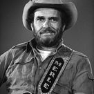 Merle Haggard (April 6, 1937 – April 6, 2016) was an American country music songwriter, singer, guitarist, fiddler, & instrumentalist. Along with Buck Owens, Haggard & his band the Strangers helped create the Bakersfield sound, which is characterized by the twang of Fender Telecaster & the unique mix with the traditional country steel guitar sound, new vocal harmony styles in which the words are minimal. In 1994, he was inducted into the Country Music Hall of Fame. He died on his 79th birthday