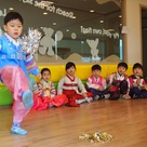 Seollal Games   A child plays jaegi chagi, a Korean hackey sack like game that is often played during Seollal, or Lunar New Year.      All of here in Seoul wish you happiness and prosperity during this year