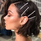 Side swept short bob hair style with hair accessories 2020