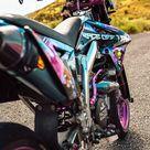 Supermoto Girl @K.im_a_biker on a Rainbow Colored, Vinyl Wrapped Custom Suzuki