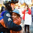 This Photo Of A Police Officer And A Young Boy Hugging At A Ferguson Protest Is Going Viral