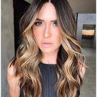 dark brown hair with face framing highlights