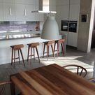 Dining & Kitchen area : Lightyears Caravaiggio pendant Lights, Carl Hansen Wishbone Chairs, E15 Sloane Table and Zeitraum Morph Stools in walnut - all from www.utilitydesign.co.uk