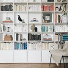 Made-to-measure wall storage in white particle board - designer and custom-made.