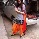 Pakistani girl in tight gray kameez and orange salwar