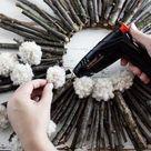 Twig & Pom Pom Starburst Wreath - A Beautiful Mess