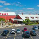 Family owned and operated Tom's Farm Market was established in 1959. It specializes in bedding plants and produce that are grown on-site and sold to the public. It is open from the end of March through December each year.
