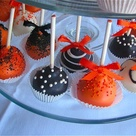Instead of a cake, cake pops in the school colors, which would make it easier to walk around and mingle.