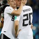 Julian Brandt and Toni Kroos of Germany celebrate after winning the...