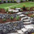 Retaining Rock Wall Ideas for a Sloped Yard - Happy Haute Home