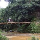 Part of the fun of riding a motorcycle is the thrill of conquering this narrow road along the river.