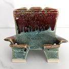 Ceramic phone holder with green and red glazes, handmade by Jason Hooper Pottery