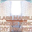 How to add glass marbles to a garden fence diy project is detailed in this step ...