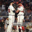 Dallas Keuchel and Tyler Flowers of the Atlanta Braves talk on the...