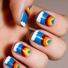 Rainbow nails design with cloud