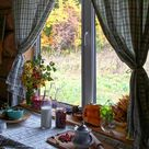 Wooden house window view with curtains