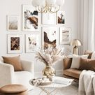 Harmonious gallery wall beige living room abstract nature posters golden frames
