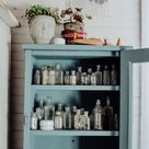 Styling A Vintage Cabinet With Antique Glass Jars