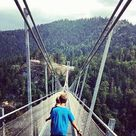 Highline 179 - longest Tibetan style pedestrian suspension bridge in the world linking two mountains over the Fern Pass in Austria