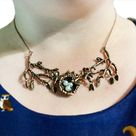 Bird nest in leafy branches necklace with a personalised message and choice of gold, silver or red copper branches.