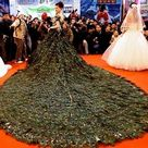 Peacock feathers    one of the world's most expensive wedding gowns... $50,000.