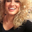 tori kelly in black dress blonde curly