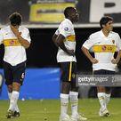 Boca Juniors' Ezequiel Munoz, Breyner Bonilla and Cristian Erbes look...