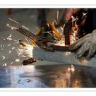 A1 Poster. A worker welds a piece of metal at a steel workshop