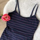 Nursing tanks set of 2 Nordstrom & Pea in the Pod Set of 2 nursing tanks both size S.   Black tank is Nordstrom Lingerie made of nylon / spandex. Adjustable size straps with inner bra lining and clip off straps in front for easy nursing. Excellent used condition, worn 1-2x only.   Navy tank with pink strips is A Pea In the Pod. Very good used condition with no flaw to note, minor wash wear. Also lined in bra area with adjustable straps and clip off straps in front for easy nursing.   Smoke free home. Nordstrom Tops Tank Tops