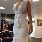 Berta Bridal pre owned mermaid wedding gown dress Authentic Berta bridal pre owned used wedding gown dress in mermaid open front and sheer back style. This dress was custom made for my size by Berta Bridal in Israel. It is equal to a size 4, i am 5'2 and