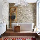 Feature stone wall framing freestanding bath