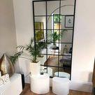 Trend hoge metalen spiegels in het interieur