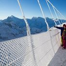 Walking in the air! World's 'scariest' and highest suspension bridge opens 1,5000ft above a glacier in the Swiss Alps