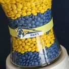 Class Reunion Centerpiece Idea - Layer M & M's in a clear glass container in your school colors.