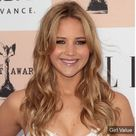 Jennifer Lawrence golden haircut style in white dress