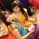Beautiful Girls in Yellow and Purple Saree