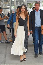 On the promo trail: She is seen in a black and white dress with a full skirt,  #…